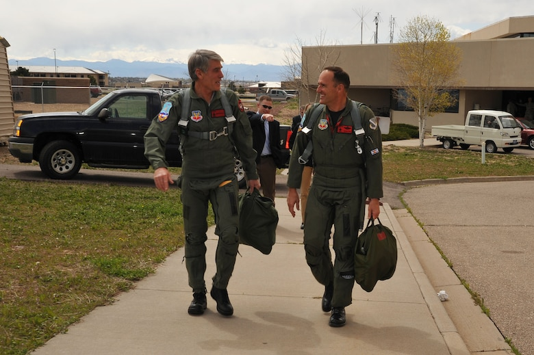 Colorado Senator Mark Udall and Brig Gen. Trulan Eyre, 140th Wing Commander, walk to the F-16 prior to takeoff Saturday, 1 May.  Mark Udall spent the day at Buckley Air Force Base with Colorado Guardsmen to further understand the Air National Guard's missions, people and weapons systems that operate in both state and federal capacities.