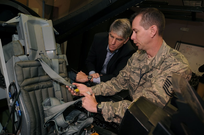 Master Sgt. Greg Roark, 120th Fighter Squadron Life Support nonommissioned officer-in-charge, instructs Senator Mark Udall on emergency F-16 egress procedures prior to his F-16 flight on Saturday, 1 May.  Mark Udall spent the day at Buckley Air Force Base with Colorado Guardsmen to further understand the Air National Guard's missions, people and weapons systems that operate in both state and federal capacities.