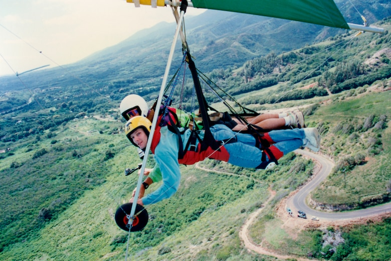 MAUI, Hawaii -- Craig Denton, front, hang glides in tandem with an instructor on Maui, Hawaii. Memorial Day 1994, Mr. Denton and his instructor crashed into the side of a mountain. Mr. Denton suffered two broken legs, a black eye, cuts across his face and a crushed cheek bone. Today, Mr. Denton, retired Air Force master sergeant and 21st Space Wing Public Affairs visual information technician, is still active in sports including mountain biking, snowboarding and hiking. He encourages Airmen to get in touch with their wing's safety office or squadron safety representative to find out all there is to know about extreme sports before trying them. (Photo courtesy Craig Denton)