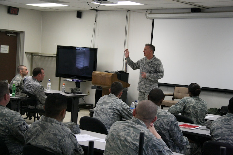 Chaplain (Col.) Gregory Tate, Air Force Space Command command chaplain, addresses members of the 5th Combat Communications Group who are currently attending Combat Readiness School - also known as MOB school, Robins Air Force Base, Ga. during his visit May 5. (US Air Force photo by 2nd Lt. Joel Cooke)