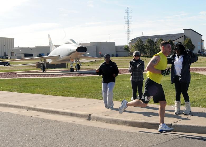 BUCKLEY AIR FORCE BASE, Colo. -- Senior Airman Jaret McGowan runs past the half way point during the 13.1 mile Annual Half Marathon. ( U.S. Air Force Photo by Airman 1st Class Marcy Glass )
