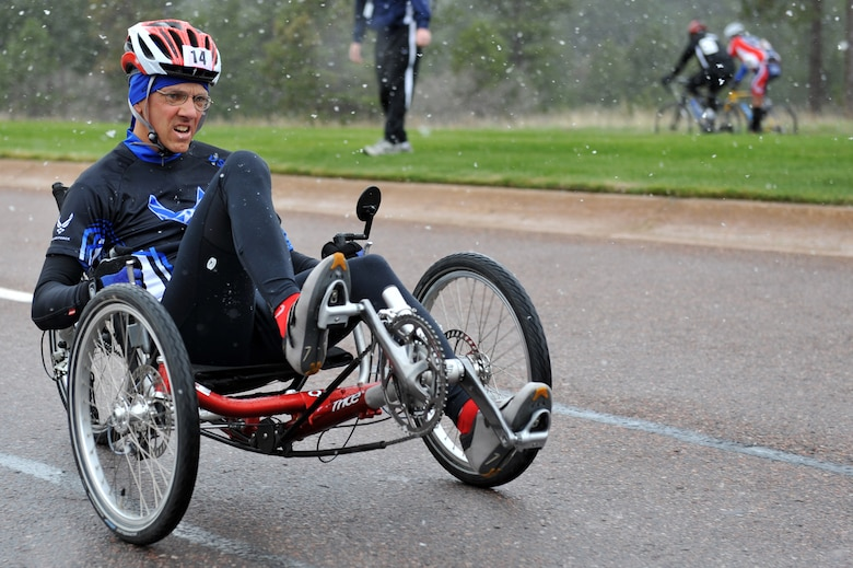 Senior Master Sgt. Michael Sanders races to the finish line of the 10-kilometer recumbent bike race  for the inaugural Warrior Games May 13, 2010, at the U.S. Air Force Academy in Colorado Springs, Colo. Sergeant Sanders is one of some 200 disabled veterans participating in the Paralympic-style competition May 10 through 14. (U.S. Air Force photo/Staff Sgt. Desiree N. Palacios)