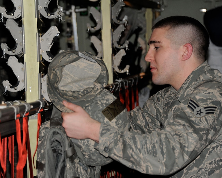 A Senior Airman of the 133rd Airlift Wing Minnesota Air National Guard secures his body armor in the cargo hold of a C-130 Hercules bound for Southwest Asia in support of Operation Enduring Freedom 13 May 2010. The aircraft and Airmen of the 133rd are deploying to Southwest Asia is support of Operation Enduring Freedom. U.S. Air Force photo by Tech. Sgt. Erik Gudmundson(released)