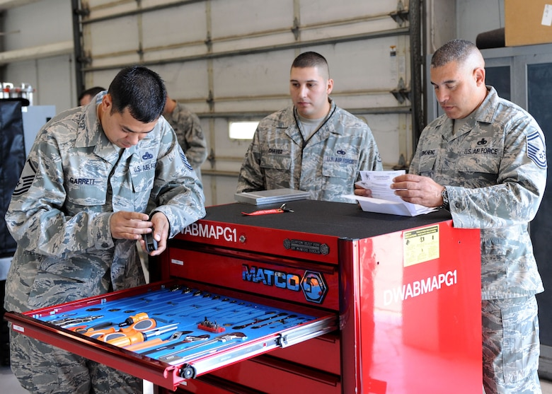 DYESS AIR FORCE BASE, Texas – Global Strike Challenge inspectors Master Sgt. Roger Garrett (left) and Senior Master Sgt. Jules Reimonenq (right) from Barksdale, La., inspect a composite tool kit May 12 here. The 7th Bomb Wing is one of seven bomb wings to participate in Air Force Global Strike Command's first load competition. The competition consists of a uniform inspection, general knowledge test, tool inspection, munitions build, weapons load and B-1 Bomber pre-flight inspection. (U.S. Air Force photo/ Airman 1st Class Chelsea Browning)