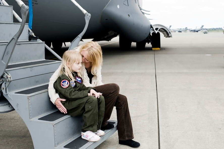Kaylie Bergen, age 6, and her mother Christy share a moment on the steps of a C-17 Globemaster III following a tour of the aircraft May 11. (U.S. Air Force Photo by Abner Guzman)