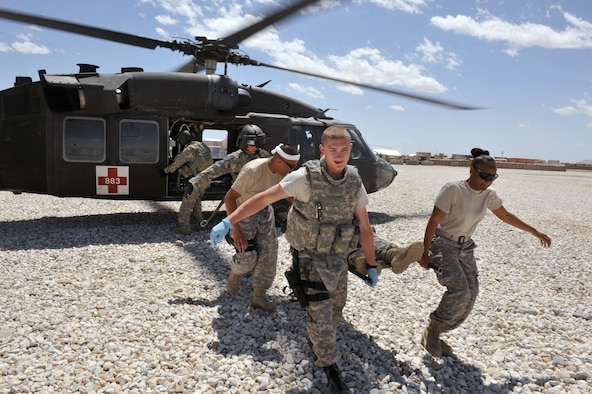 Staff Sgt. Shante Lopez (right) and Senior Airman Austin Hess (left) carry a Soldier on a litter from an aeromedical evacuation area at Forward Operating Base Ghazni, Afghanistan, April 22, 2010. Sergeant Lopez is deployed from the 10th Medical Group at the Air Force Academy in Colorado Springs, Colo. (U.S. Air Force photo/Tech. Sgt. JT May III)