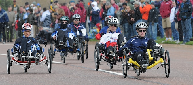 Mike Bell of the Coast Guard and Senior Master Sgt. Michael Sanders of the Air Force lead the pack during the Warrior Games' recumbent bicycle 10k May 13, 2010, at the Air Force Academy in Colorado Springs, Colo. Sanders smoked the competition, finishing in 24:03 to win gold. The Marines' Angel Gomes took silver with 30:07, and Bell earned the bronze with a time of 30:08. (U.S. Air Force photo/Rachel Boettcher)