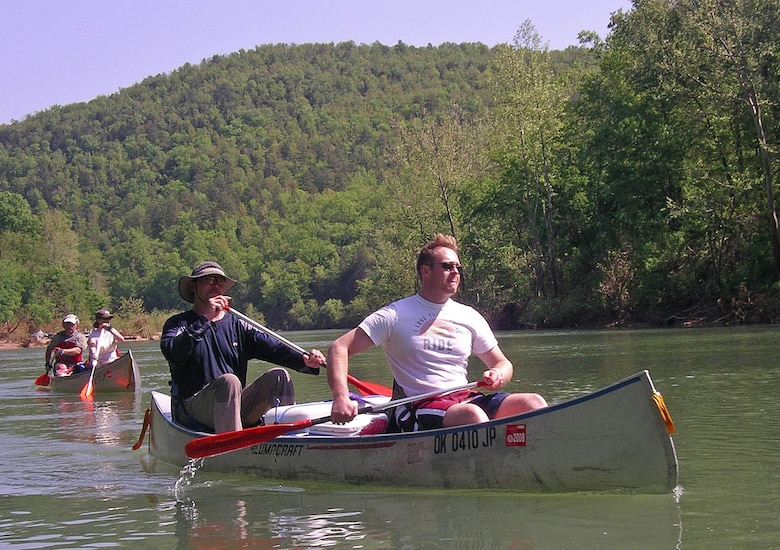 Outdoor enthusiasts Mat Burton, from right, and Erik Jones paddle down Arkansas' Buffalo River on an Outdoor Recreation excursion in 2008. Jones has participated in a number of Outdoor Rec trips and offers his outdoors expertise across the board, from canoeing to mountain climbing. (Courtesy photo)