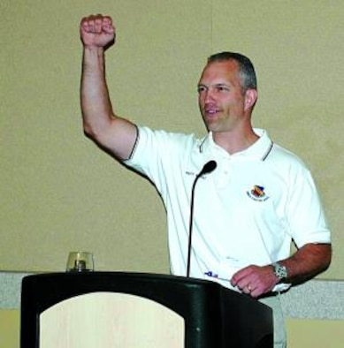 Chief Master Sgt. Marty Klukas, command chief of the Air Combat Command, cheers on those present at the 421st Fighter Squadron reunion banquet May 8 at Davis County Convention Center in Layton.