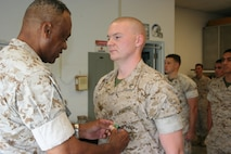 Lance Corporal Jonathan D. Raybon, Ground Electronics Maintenance Division, Headquarters and Headquarters Squadron, Marine Corps Air Station, Camp Pendleton is awarded the Navy and Marine Corps Achievement Medal.
