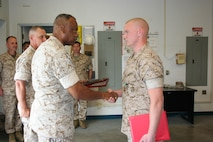 Major General Anthony L. Jackson, Commanding General, MCIWEST awarded Lance Corporal Jonathan D. Raybon, Ground Electronics Maintenance Division, Headquarters and Headquarters Squadron, Marine Corp Air Station, Camp Pendleton the Navy and Marine Corps Achievement Medal.