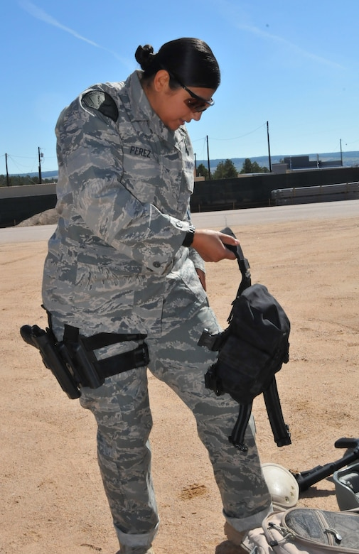 Officer Yvette Perez from the Space and Missile Systems Center's 61st Security Forces Squadron prepares to put on her gear for the marksmanship competition at Guardian Challenge 2010 May 17. (Photo by Lou Hernandez)