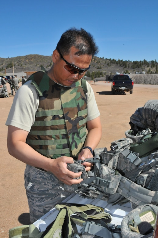 Tech. Sgt. Rochanapan Silpe from the Space and Missile Systems Center's 61st Security Forces Squadron prepares his gear before the marksmanship competition for Guardian Challenge 2010 May 17. (Photo by Lou Hernandez)
