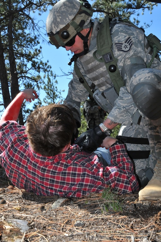 Staff Sgt. Alex Andriyanov from the 61st Security Forces Squadron, Space and Missile Systems Center, checks the injuries on a simulated local national during the tactics competition at Guardian Challenge May 16, 2010. (Photo by Lou Hernandez)