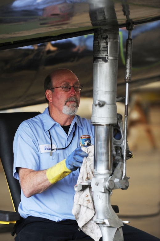 DAYTON, Ohio (04/2010) -- A restoration specialist works on the F-84 in the Restoration Hangar at the National Museum of the U.S. Air Force. (U.S. Air Force photo/Master Sgt. William Greer)
