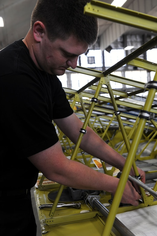 "DAYTON, Ohio (04/2010) -- Restoration specialist Nick Almeter works on the B-17F ""Memphis Belle"" in the Restoration Hangar at the National Museum of the U.S. Air Force. (U.S. Air Force photo/Master Sgt. William Greer)"
