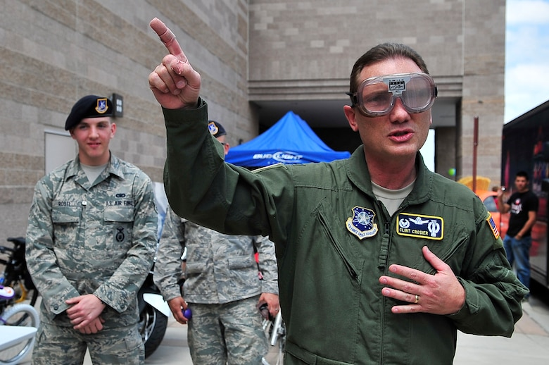 """BUCKLEY AIR FORCE BASE, Colo. --  Colonel Clint Crosier, 460th Space Wing commander, talks about the dangers of drinking and driving after donning a pair of """"fatal vision"""" goggles, May 14. Fatal Vision goggles simulate vision impaired by the effects of alcohol consumption. (U.S. Air Force photo by Staff Sgt. Kathrine McDowell)"""