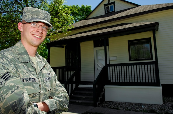 MINOT, N.D. – Senior Airman Benjamin Stratton, 5th Bomb Wing public affairs, poses for a photo outside his newly purchased home here May 18. Becoming a home owner was an opportunity for Airman Stratton to accomplish his own American dream and have his very own Minot Adventure. (U.S. Air Force photo by Tech. Sgt. Thomas Dow)