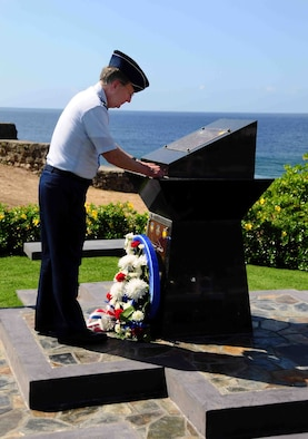 "AGANA, GUAM – Lt. Gen. Frank G. Klotz, Air Force Global Strike Command commander, places his ""commander's coin"" on the memorial to Raider 21, after laying a wreath at the site commemorating the B-52 crew that was lost when their B-52 went down in the Pacific  on Guam's Liberation Day on July  21,  2008.  General Klotz visited the memorial during a trip to Guam and Andersen Air Force Base where he got a firsthand look at the continuous bomber presence mission.  (U.S. Air Force photo by Airman 1st Class Jeffrey Schultze)"