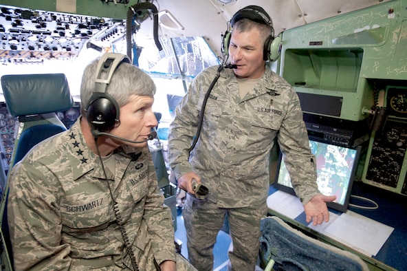 Air Force Chief of Staff Gen. Norton Schwartz listens as Senior Master Sgt. Scott Curran, superintendent of international and expeditionary education and training at the U.S. Air Force School of Aerospace Medicine, explains the mission scenarios and emergency procedures taught in the C-130 Hercules simulators to better prepare aircrews responsible for the medical evacuation of patients. General Schwartz was visiting the school May 13, 2010, at Brooks City-Base in San Antonio.  (U.S. Air Force photo/Steve Thurow)