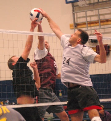 SCHRIEVER AIR FORCE BASE, Colo. -- Team Schriever's Bill Witwicky and Craig Armogida battle a Team Peterson player for control at the net during round-robin play in the Rocky Mountain Volleyball Championships at the fitness center here. (U.S. Air Force photo/Scott Prater)