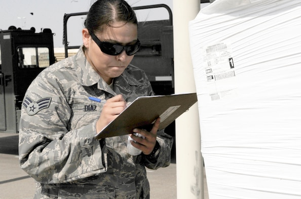 Senior Airman Anita Diaz, an air transportation journeyman with the 380th Expeditionary Logistics Readiness Squadron's Air Terminal Operations Center supporting operations for the 380th Air Expeditionary Wing, calculates data for a pallet of cargo at a non-disclosed base in Southwest Asia on Feb. 16, 2010. Airman Diaz is deployed from the 89th Aerial Port Squadron at Joint Base Andrews, Md., and her hometown is Merced, Calif. (U.S. Air Force Photo/Capt. Cathleen Snow/Released)