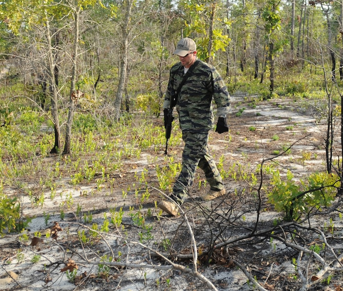 Mathew Comeau, 1st Special Operations Support Squadron Range Support flight opposition forces member, scans for tracks from Survival, Evasion, Resistance and Escape students during combat survival training at an undisclosed location in the Eglin Range, Fla., May 13, 2010. OPFOR provides support capabilities to 1st Special Operations Wing aircraft and ground assets, and, when available, other Air Force Special Operations Command, Air Force and joint partners who request them.  (DoD photo by U.S. Air Force Senior Airman Matthew Loken)