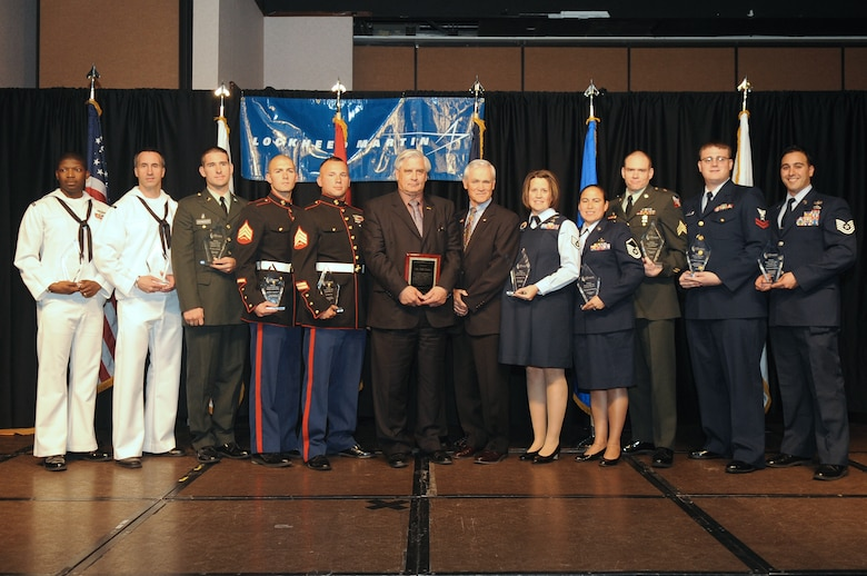 BUCKLEY AIR FORCE BASE, Colo.-- Winners from all United States Military components gather for a group photo at the 37th Annual Armed Forces Recognition Luncheon held at the Crown Plaza hotel, May 14, 2010. (U.S. Air Force Photo by Airman 1st Class Manisha Vasquez)