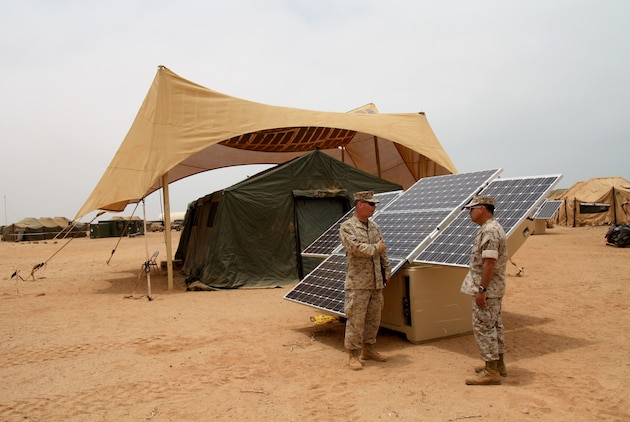 Maj. Sean M. Sadlier (left) of the U.S. Marine Corps Expeditionary Energy Office explains the solar power element of the Expeditionary Forward Operating Base concept to Col. Anthony Fernandez during the testing phase of this sustainable energy initiative here May 19.  The ExFOB is designed primarily for use by small Marine Corps units at forward operating bases in Afghanistan.  Fernandez, a Marine Corps Reservist with a combined 28 years in the Corps, is the African Lion 2010 task force commander here.