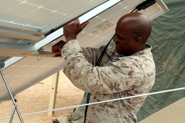 Master Gunnery Sgt. Rowan Dickson locks down a solar panel in a power generating module for the Expeditionary Forward Operating Base system during a testing and evaluation phase of this sustainable energy initiative May 19, 2010.  This was just one element of African Lion 2010, a month-long theater security cooperation exercise led by Marine Forces Africa with troop support from Marine Forces Reserve.  More than 700 active duty and reserve Marines and sailors from Marine Forces Reserve are participating in African Lion this year.