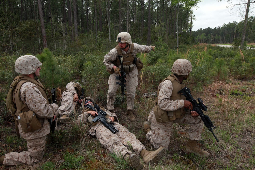 Marines with Mobility Assault Company, 2nd Combat Engineer Battalion, 2nd Marine Division, work to evacuate a mock casualty during training March 30. The scenario required Marines to transport the fallen Marine and use proper radio techniques to call for support during the three-day Improvised Explosive Device Awareness course.  The battalion is currently preparing its Marines for an upcoming deployment to Afghanistan.