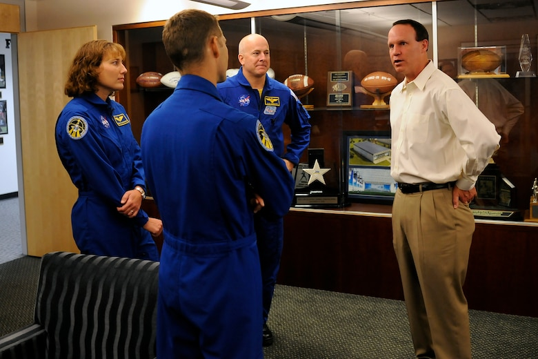 "From left: Dorothy Metcalf-Lindenberger, Col. Jim Dutton and Navy Capt. Alan Poindexter talk with Air Force football head coach Troy Calhoun during a ""NASA victory tour"" visit to the Academy May 18, 2010. The three astronauts were part of the crew for the Space Shuttle Atlantis' STS-131 mission to the International Space Station in April. (U.S. Air Force photo/J. Rachel Spencer)"