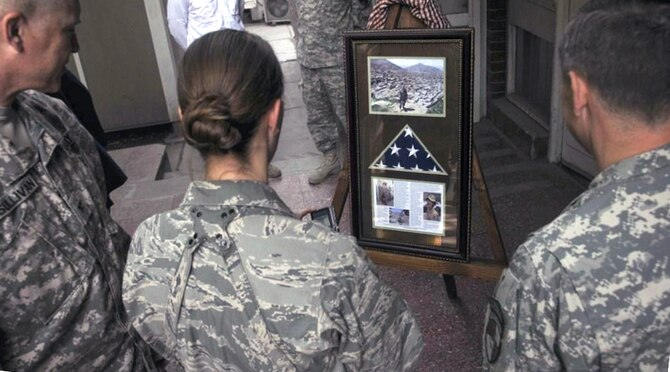 Servicemembers deployed to Kabul, Afghanistan, view a memorial presentation in honor of 1st Lt. Roslyn Schulte May 20, 2010. Lieutenant Schulte, a 2006 graduate of the Air Force Academy in Colorado Springs, Colo., was killed May 20, 2009, by an improvised explosive device, along with retired Lt. Col. Shawn Pine. (U.S. Air Force photo/Staff Sgt. Rachel Martinez)