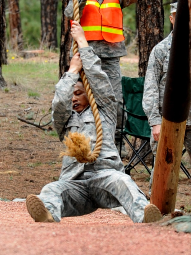 Tech. Sgt. Rochanapan Silpe swings on a rope to cross a water hazard at the Guardian Challenge 2010's obstacle course May 19 during the final portion of the security forces competition. Both are members from the Space and Missile Systems Center's 61st Security Forces Squadron. (Photo by Lou Hernandez)