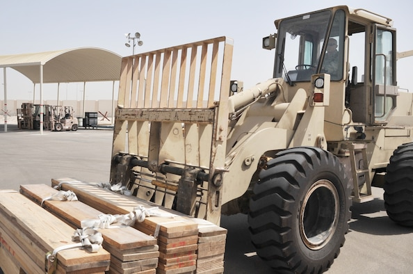 Senior Airman Nicholas Worrell, air transportation journeyman with the 380th Expeditionary Logistics Readiness Squadron Air Terminal Operations Center, drives an extreme terrain forklift in the ATOC yard during operations for the 380th Air Expeditionary Wing at a non-disclosed base in Southwest Asia on May 19, 2010. Airman Worrell is deployed from the 89th Aerial Port Squadron at Joint Base Andrews, Md., and his hometown is Robins, Iowa. (U.S. Air Force Photo/Master Sgt. Scott T. Sturkol/Released)