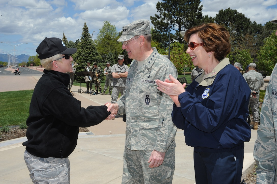 Gen. C. Robert Kehler (middle), Commander of Air Force Space Command, greets Col. Anita Latin (left), Commander of the 61st Air Base Wing at Los Angeles Air Force Base during the Guardian Challenge 2010 Arrival Ceremony May 20 at Peterson AFB, Colo. General Kehler is joined by Marj Kehler (right). (Photo by Lou Hernandez)