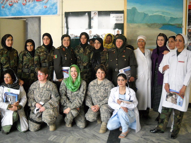 Lt . Col. Bernadette Anderson and the Afghan nursing students celebrate Women's Day together. (Courtesy Photo)