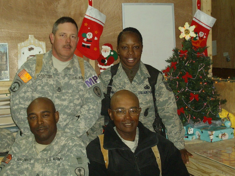 BARKSDALE AIR FORCE BASE, La. – Master Sgt. Keisha Yarbrough, top right, stops for a quick holiday picture with her fellow deployed servicemembers in December 2008. Sergeant Yarbrough was recently honored as the 2009 Air Force Global Strike Command First Sergeant and Outstanding Airman of the Year.  (Courtesy Photo)