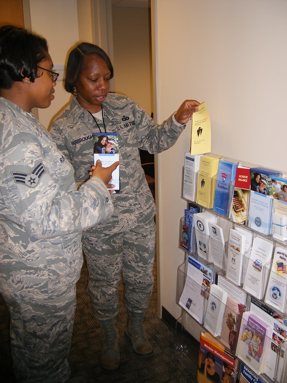 BARKSDALE AIR FORCE BASE, La. – Master Sgt. Keisha Yarbrough shows a Barksdale Airman information on the different agencies on base. Sergeant Yarbrough was recently honored as the 2009 Air Force Global Strike Command First Sergeant and Outstanding Airman of the Year.  (Courtesy Photo)