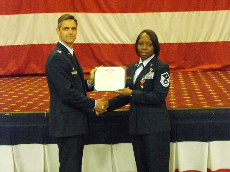 "BARKSDALE AIR FORCE BASE, La. – Col. Steven L. Basham, 2d Bomb Wing commander, presents Master Sgt. Keisha Yarbrough the Bronze Star for her oustanding performance as a ""Sergeant of the Guard"" while deployed to Camp Bucca, Iraq, from 2007 to 2008. Sergeant Yarbrough was recently honored as the 2009 Air Force Global Strike Command First Sergeant and Outstanding Airman of the Year.  (Courtesy Photo)"