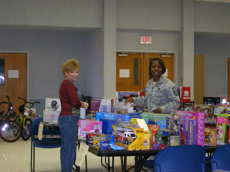 BARKSDALE AIR FORCE BASE, La. – Master Sgt. Keisha Yarbrough participates in a toy drive to help underprivileged  children.  Sergeant Yarbrough was recently honored as the 2009 Air Force Global Strike Command First Sergeant and Outstanding Airman of the Year.  (Courtesy Photo)