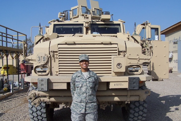 Tech. Sgt. Erin Connolly, 509th Medical Operations Squadron bioenvironmental technician, stands in front of the newest mine resistant ambush protected vehicle, which arrived in Iraq, Dec. 1, 2009.
