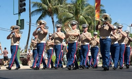 Musicians with the U.S. Marine Corps Forces, Pacific Band, march and perform in the Military Appreciation Day Parade May 22 in Waikiki, Hawaii. This year's Military Appreciation Day Parade was the first since 2006.