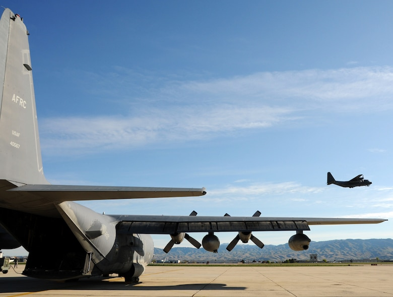 MC-130 Combat Talon #572 lifts off on its final flight mission as Talon #567 waits to go, May 7 at Gowen Field, Idaho.  919th maintainers were sent to Gowen Field to prepare four Talons to take off for one more mission – a flight into retirement and decommissioning.  Three of the Talons flew to Davis-Monthan Air Force Base, Ariz.  The other went to Hurlburt Field, Fla., to be placed in the Air Force Special Operations Command airpark.  (U.S. Air Force photo/Tech. Sgt. Samuel King Jr.)