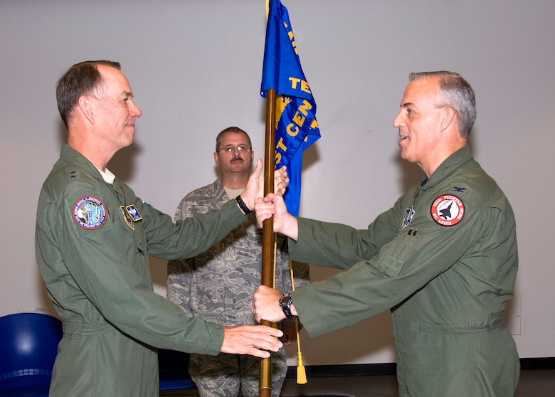 Col. Richard Dennee, right, assumes command of the Air National Guard Air Force Reserve Command Test Center with a symbolic passing of the AATC guideon from Maj. Gen. Rick Moisio, Air National Guard deputy director, May 21. (Air Force photo by Master Sgt. Dave Neve)