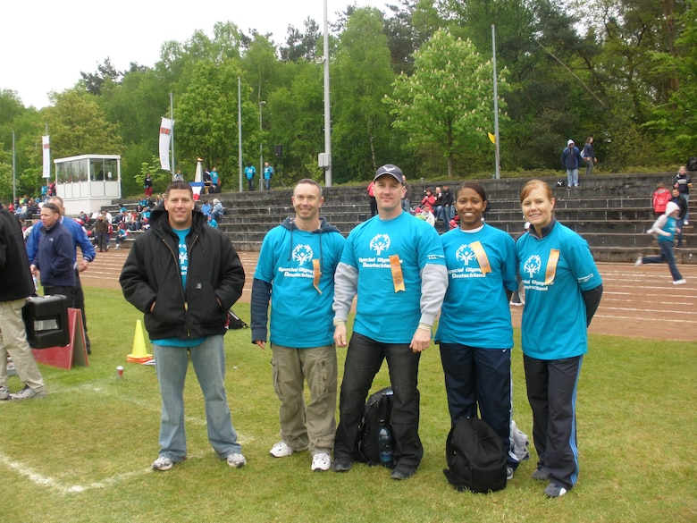 KAISERSLAUTERN, Germany – From left to right: Tech. Sgt. Austin Lewis, Master Sgt. Anthony Bickerton, Master Sgt. Brian Rogers, Staff Sgt. Brandi Washington and Shari Sims, all from the 726th Air Mobility Squadron, volunteer their time at the Special Olympics Day May 12 in Kaiserslautern, Germany. The volunteers are members of Spangdahlem's local Airlift Tanker Association chapter, the Halvorson Chapter. (U.S. Air Force photo/Staff Sgt. Candace Sloan)