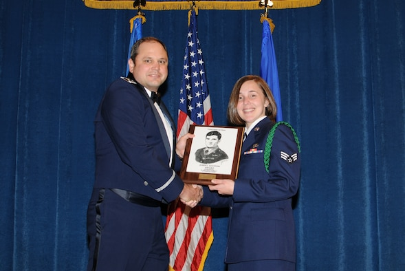 McGHEE TYSON AIR NATIONAL GUARD BASE, Tenn. -- Senior Airman Jessica N. Webb, right, a command post controller with the 118th Airlift Wing in Nashville, Tenn., receives the John L. Levitow honor award for Airman Leadership School Class 10-3 at The I.G. Brown Air National Guard Training and Education Center here from Maj. James K. Evans, TEC TV branch chief, May 20, 2010.  The John L. Levitow award is the highest honor awarded a graduate of any Air Force enlisted professional military education course.  (U.S. Air Force photo by Master Sgt. Kurt Skoglund/Released)