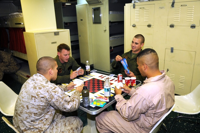 Marine Attack Squadron 513 Marines enjoy their off time playing spades in the crew quarters of the USS Bonhomme Richard, which is afloat near the coast of San Clemente Island, Calif., after a day of landing and refueling AV-8B Harriers May 25, 2010. The squadron supported the first Exercise Dawn Blitz, an exercise that affords Marines and sailors an opportunity to practice large-scale amphibious assault operations that combine long-range support and close-air support over a two-week period. The Corps intends to hold the exercise annually.