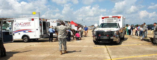 NEW ORLEANS -- Ambulances from local hospitals pull up next to the Disaster Aeromedical Staging Facility to offload simulated patients during an evacuation exercise at the New Orleans Lakefront Airport May 19. The exercise was controlled by the Louisiana Department of Health and Hospitals with the help of multiple military counterparts including Air Mobility Command and U.S. Transportation Command members from Scott AFB. (U.S. Air Force photo by Senior Airman Samantha S. Crane)