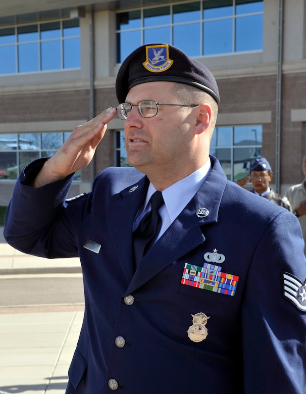 BUCKLEY AIR FORCE BASE, Colo. -- Staff Sgt. Thomas Gehres, 460th Security Forces Squadron, salutes the American Flag during a retreat ceremony for National Police Week May 10. (U.S. Air Force photo by Airman 1st Class Paul Labbe)